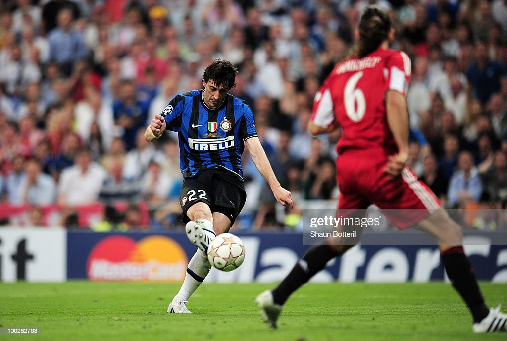 <a gi-track='captionPersonalityLinkClicked' href=/galleries/search?phrase=Diego+Milito&family=editorial&specificpeople=689963 ng-click='$event.stopPropagation()'>Diego Milito</a> of Inter Milan scores the second goal during the UEFA Champions League Final match between FC Bayern Muenchen and Inter Milan at the Estadio Santiago Bernabeu on May 22, 2010 in Madrid, Spain.