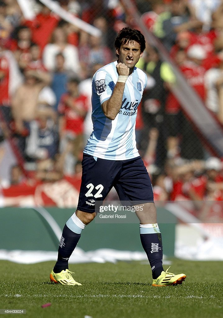 <a gi-track='captionPersonalityLinkClicked' href=/galleries/search?phrase=Diego+Milito&family=editorial&specificpeople=689963 ng-click='$event.stopPropagation()'>Diego Milito</a> of Racing Club celebrates after scoring the opening goal against Independiente during a match between Independiente and Racing as part of fifth round of Torneo de Transicion 2014 at Libertadores de America Stadium on August 31, 2014 in Buenos Aires, Argentina.