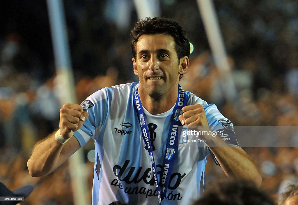 <a gi-track='captionPersonalityLinkClicked' href=/galleries/search?phrase=Diego+Milito&family=editorial&specificpeople=689963 ng-click='$event.stopPropagation()'>Diego Milito</a> of Racing Club celebrates the championship after winning a match between Racing Club and Godoy Cruz as part of 19th round of Torneo de Transicion 2014 at Presidente Peron Stadium on December 14, 2014 in Buenos Aires, Argentina.