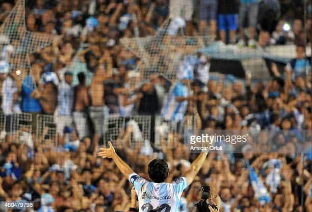 Diego Milito of Racing Club celebrates the championship with fans after winning a match between Racing Club and Godoy Cruz as part of 19th round of...