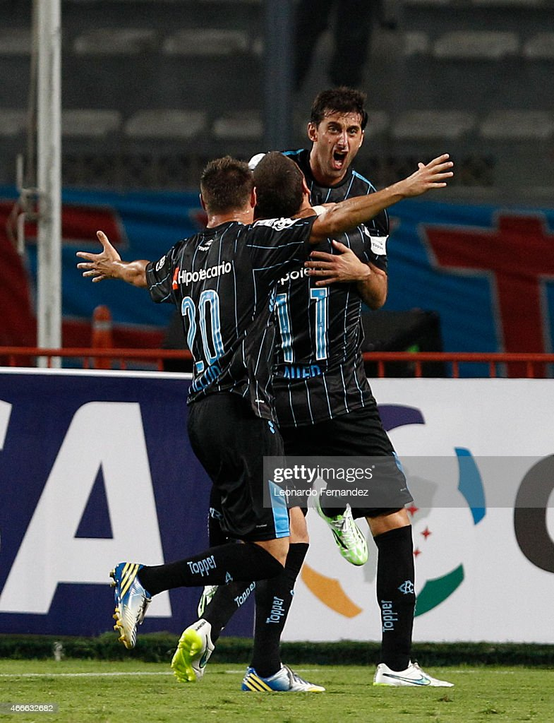 Diego Milito of Racing Club celebrates the first goal of his team against Sporting Cristal during a match between Sporting Cristal and Racing Club as part of Copa Bridgestone Libertadores 2015 at Nacional Stadium on March 17, 2015 in Lima, Peru.