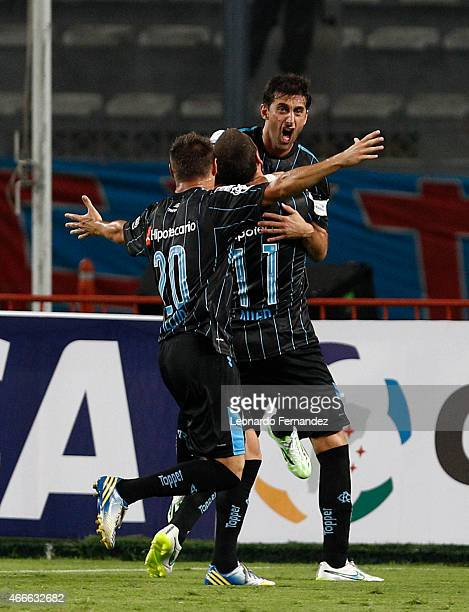 Diego Milito of Racing Club celebrates the first goal of his team against Sporting Cristal during a match between Sporting Cristal and Racing Club as...