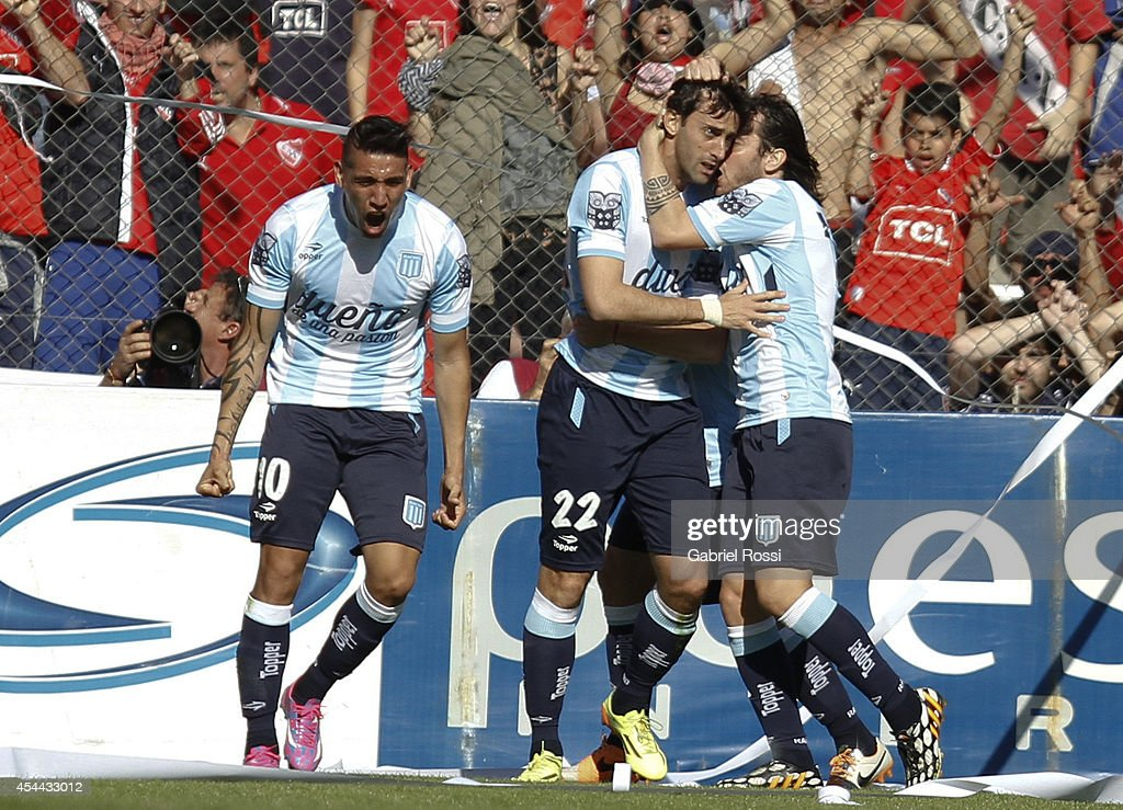 <a gi-track='captionPersonalityLinkClicked' href=/galleries/search?phrase=Diego+Milito&family=editorial&specificpeople=689963 ng-click='$event.stopPropagation()'>Diego Milito</a> of Racing Club celebrates with his teammates after scoring the opening goal against Independiente during a match between Independiente and Racing as part of fifth round of Torneo de Transicion 2014 at Libertadores de America Stadium on August 31, 2014 in Buenos Aires, Argentina.
