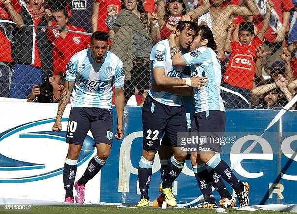 Diego Milito of Racing Club celebrates with his teammates after scoring the opening goal against Independiente during a match between Independiente...
