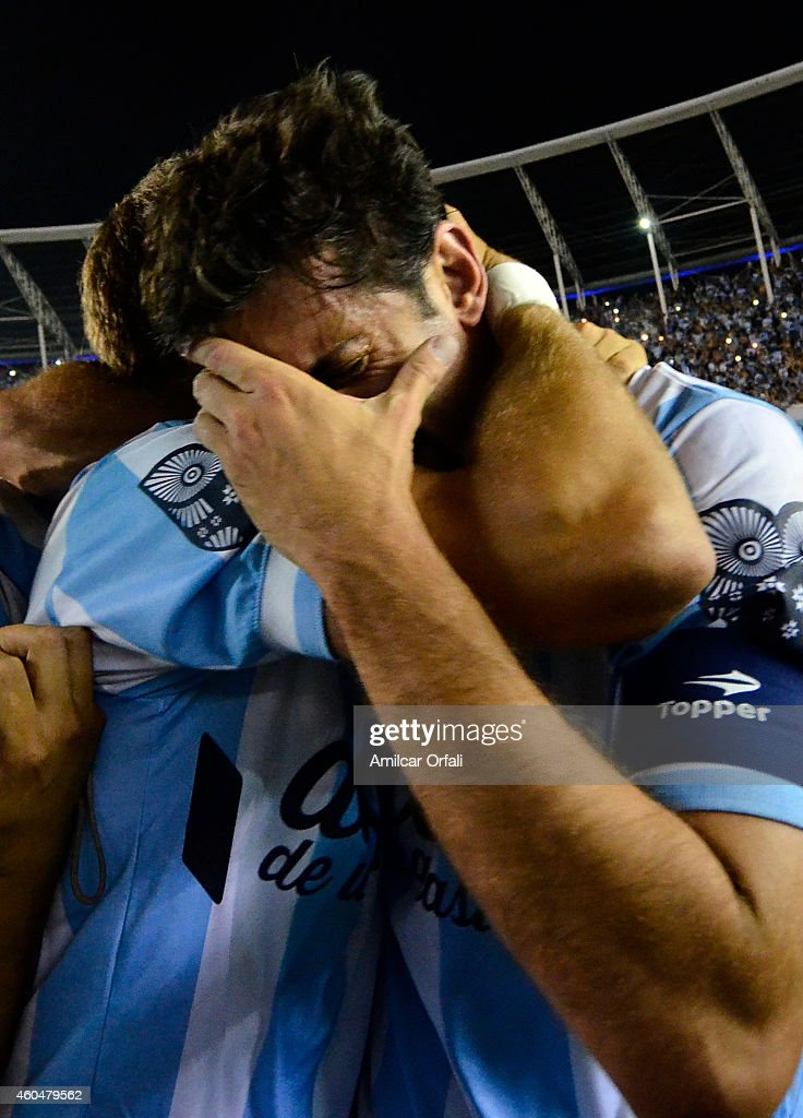 <a gi-track='captionPersonalityLinkClicked' href=/galleries/search?phrase=Diego+Milito&family=editorial&specificpeople=689963 ng-click='$event.stopPropagation()'>Diego Milito</a> of Racing Club cries while celebrating the championship after winning a match between Racing Club and Godoy Cruz as part of 19th round of Torneo de Transicion 2014 at Presidente Peron Stadium on December 14, 2014 in Buenos Aires, Argentina.