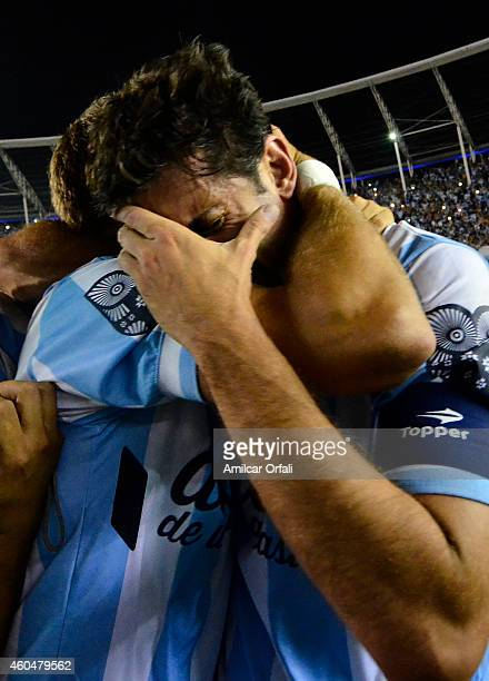 Diego Milito of Racing Club cries while celebrating the championship after winning a match between Racing Club and Godoy Cruz as part of 19th round...