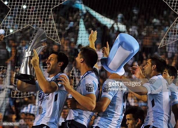 Diego Milito of Racing Club holds the trophy and celebrates the championship after winning a match between Racing Club and Godoy Cruz as part of 19th...