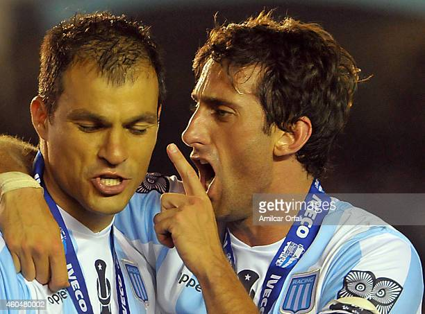 Diego Milito of Racing Club talks to Sebastian Saja of Racing Club after winning a match between Racing Club and Godoy Cruz as part of 19th round of...