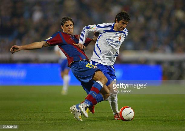 Diego Milito of Zaragoza and Edmilson of Barcelona in action during the La Liga match between Real Zaragoza and FC Barcelona at the La Romareda...