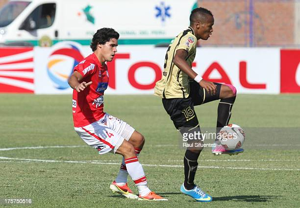 Diego Minaya of Juan Aurich fights for the ball with Luis Quinones of Itagui during a match between Juan Aurich and Itagui as part of The Copa Total...