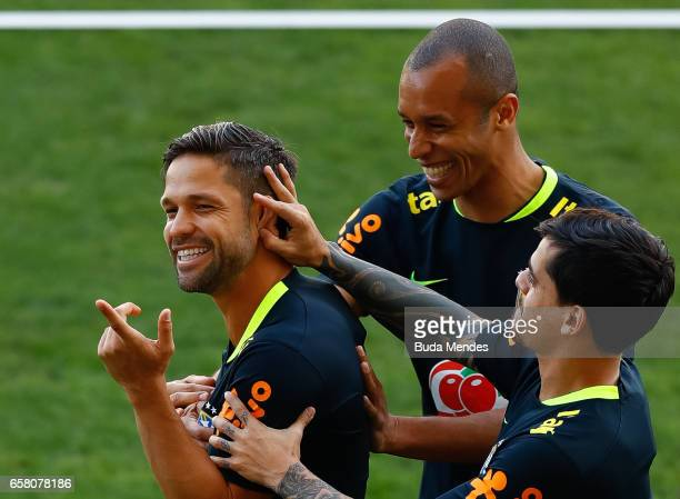 Diego Miranda Fagner of Brazil joke during a training session at Arena Corinthians on March 26 2017 in Sao Paulo Brazil
