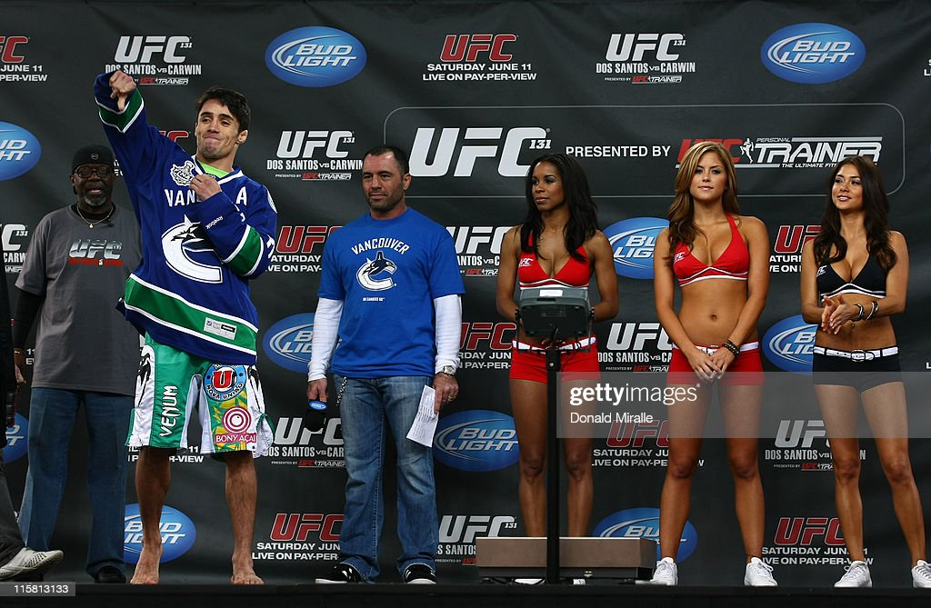 Diego Nunes (left) gets a rousing reception from the fans as he walks on stage wearing a Vancouver Canucks jersey at the UFC 131 weigh-in at Jack Poole Plaza on June 10, 2011 in Vancouver, British Columbia, Canada.