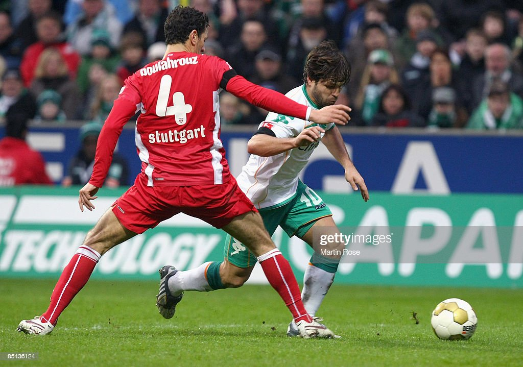Diego of Bremen (R) and Khalid Boulahrouz(L) of Stuttgart battle for the ball during the Bundesliga match between Werder Bremen and VfB Stuttgart at the Weser stadium on March 15, 2009 in Bremen, Germany.