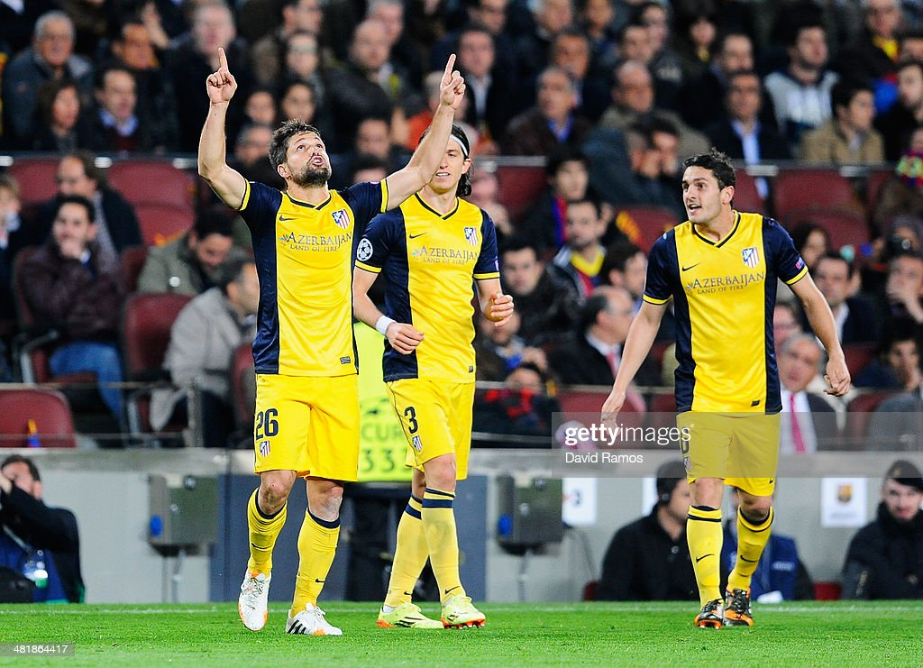 Diego (L) of Club Atletico de Madrid celebrates scoring the opening goal with <a gi-track='captionPersonalityLinkClicked' href=/galleries/search?phrase=Filipe+Luis&family=editorial&specificpeople=3941966 ng-click='$event.stopPropagation()'>Filipe Luis</a> and Koke (R) of Club Atletico de Madrid during the UEFA Champions League Quarter Final first leg match between FC Barcelona and Club Atletico de Madrid at Camp Nou on April 1, 2014 in Barcelona, Spain.
