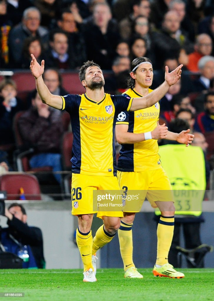 Diego (L) of Club Atletico de Madrid celebrates scoring the opening goal with Filipe Luis during the UEFA Champions League Quarter Final first leg match between FC Barcelona and Club Atletico de Madrid at Camp Nou on April 1, 2014 in Barcelona, Spain.
