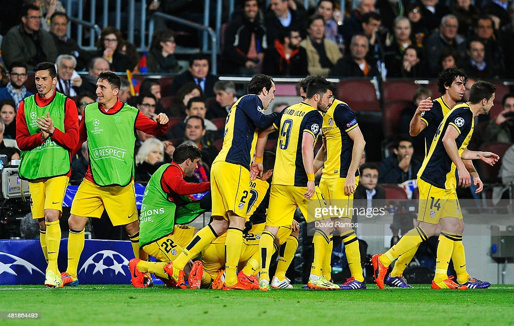 Diego of Club Atletico de Madrid is mobbed by team mates after scoring the opening goal during the UEFA Champions League Quarter Final first leg match between FC Barcelona and Club Atletico de Madrid at Camp Nou on April 1, 2014 in Barcelona, Spain.