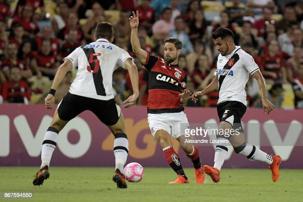 Diego of Flamengo battles for the ball with Andres Rios of Vasco da Gama during the match between Flamengo and Vasco da Gama as part of Brasileirao...