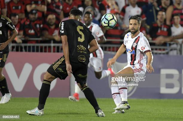 Diego of Flamengo battles for the ball with Naldo of Ponte Preta during the match between Flamengo and Ponte Preta as part of Brasileirao Series A...