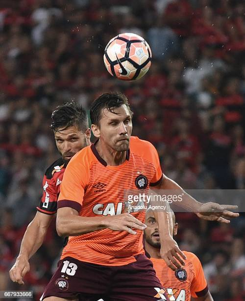 Diego of Flamengo in action against Paulo Andre of Atletico Paranaense during a match between Flamengo and Atletico Paranaense as part of Copa...