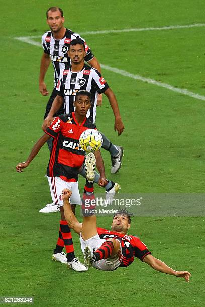 Diego of Flamengo kicks the ball with of Botafogo during a match between Flamengo and Botafogo as part of Brasileirao Series A 2016 at Maracana...