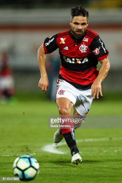 Diego of Flamengo kiss the ball during a match between Flamengo and Gremio as part of Brasileirao Series A 2017 at Ilha do Urubu Stadium on July 13...