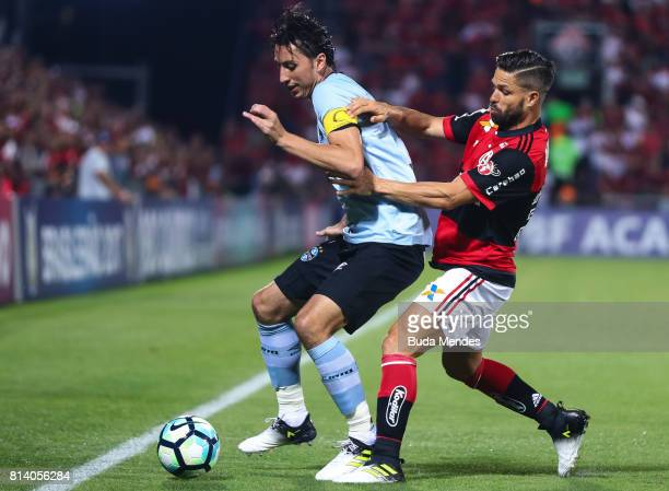 Diego of Flamengo struggles for the ball with Geromel of Gremio during a match between Flamengo and Gremio as part of Brasileirao Series A 2017 at...