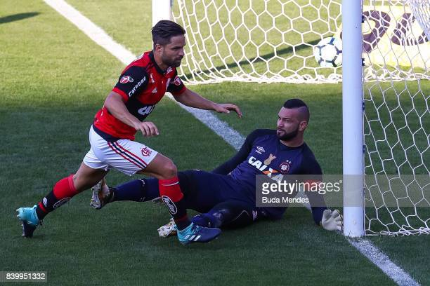 Diego of Flamengo struggles for the ball with goalkeeper Weverton of Atletico PR during a match between Flamengo and Atletico PR as part of...