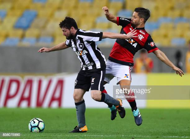 Diego of Flamengo struggles for the ball with Joao Paulo of Botafogo during a match between Flamengo and Botafogo part of Copa do Brasil SemiFinals...