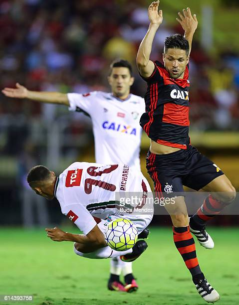 Diego of Flamengo struggles for the ball with Richarlison of Fluminense during a match between Fluminense and Flamengo as part of Brasileirao Series...
