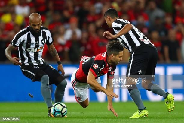 Diego of Flamengo struggles for the ball with Rodrigo Lindoso R and Bruno Silva of Botafogo during a match between Flamengo and Botafogo part of Copa...