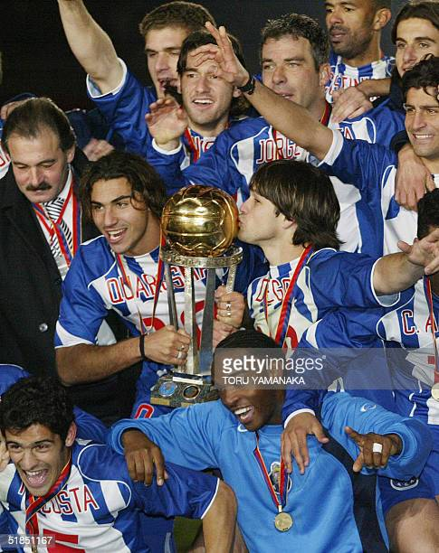 Diego of Portugese club FC Porto kisses the Intercontinental Cup as he shares a joy with his teammates during the awarding ceremony of the...