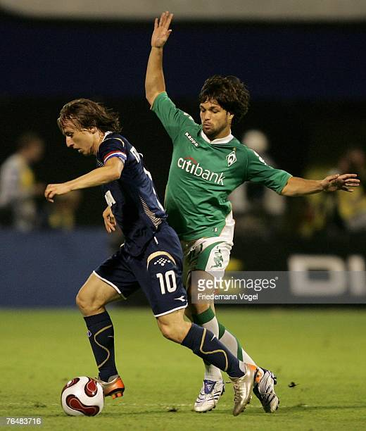 Diego of Werder fights for the ball with Luka Modric of Zagreb during the Champions League third qualifying round second leg match between Dinamo...