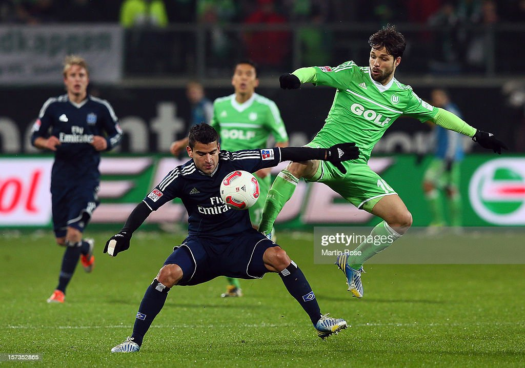 Diego (R) of Wolfsburg and <a gi-track='captionPersonalityLinkClicked' href=/galleries/search?phrase=Tomas+Rincon&family=editorial&specificpeople=1009045 ng-click='$event.stopPropagation()'>Tomas Rincon</a>(L) of Hamburg battle for the ball during the Bundesliga match between VfL Wolfsburg and Hamburger SV at Volkswagen Arena on December 2, 2012 in Wolfsburg, Germany.