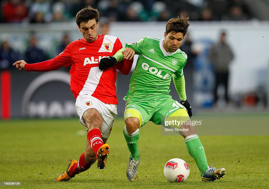 Diego (R) of Wolfsburg battles for the ball with Jan Movarek (L) of Augsburg during the Bundesliga match between VFL Wolfsburg and FC Augsburg at Volkswagen Arena on February 2, 2013 in Wolfsburg, Germany.