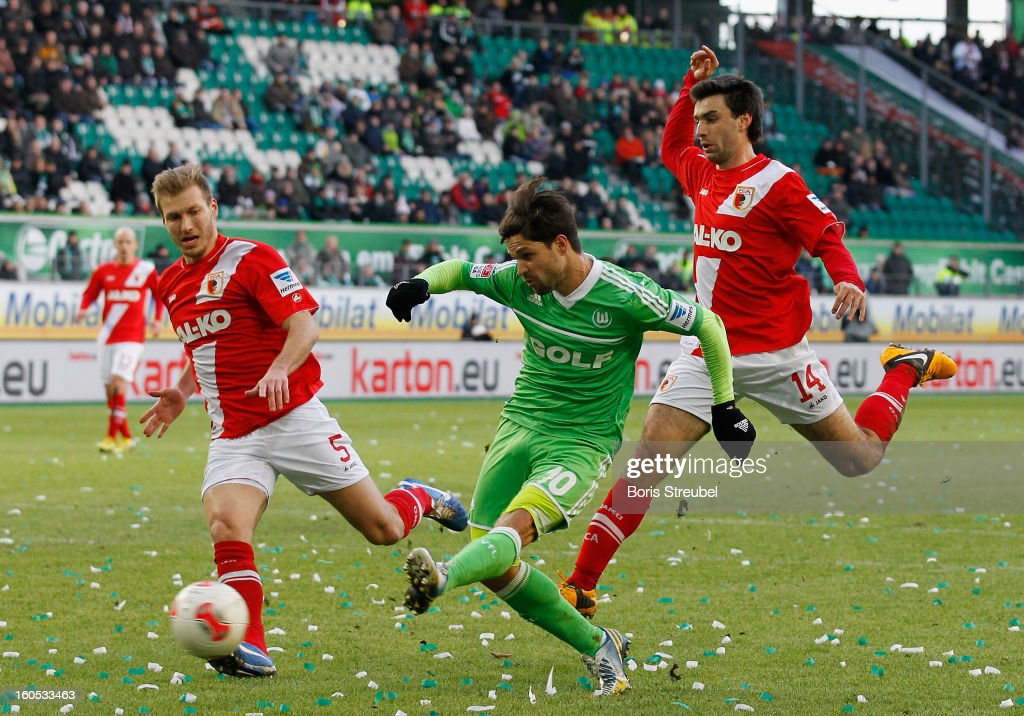 Diego (C) of Wolfsburg battles for the ball with Ragnar Klavan (L) and Jan Movarek (R) of Augsburg during the Bundesliga match between VFL Wolfsburg and FC Augsburg at Volkswagen Arena on February 2, 2013 in Wolfsburg, Germany.
