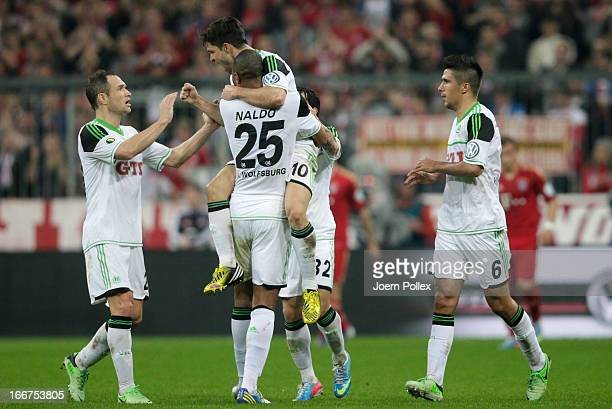 Diego of Wolfsburg celebrates after scoring his team's first goal during the DFB Cup Semi Final match between Bayern Muenchen and VfL Wolfsburg at...