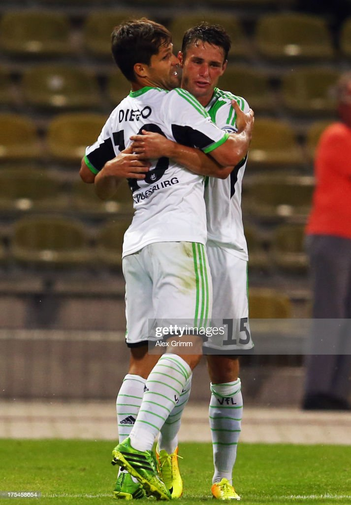 Diego (front) of Wolfsburg celebrates his team's second goal with team mate <a gi-track='captionPersonalityLinkClicked' href=/galleries/search?phrase=Christian+Traesch&family=editorial&specificpeople=5482851 ng-click='$event.stopPropagation()'>Christian Traesch</a> during the DFB Cup first round match between Karlsruher SC and VfL Wolfsburg at Wildparkstadion on August 3, 2013 in Karlsruhe, Germany.