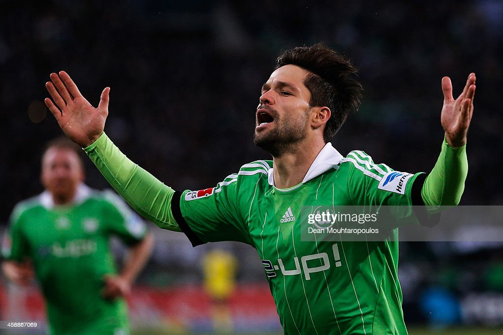 Diego of Wolfsburg celebrates scoring a goal during the Bundesliga match between Borussia Moenchengladbach and VfL Wolfsburg held at Borussia-Park on December 22, 2013 in Moenchengladbach, Germany.
