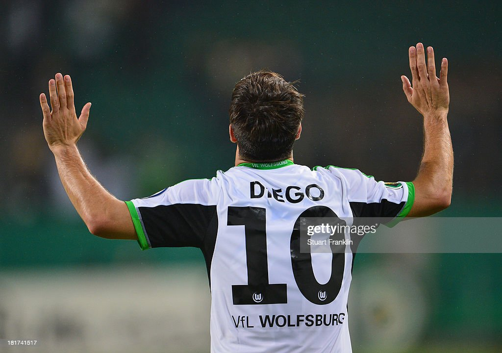 Diego of Wolfsburg celebrates scoring his goal during the second round DFB cup match between VfL Wolfsburg and Vfr Aalen at Volkswagen Arena on September 24, 2013 in Wolfsburg, Germany.