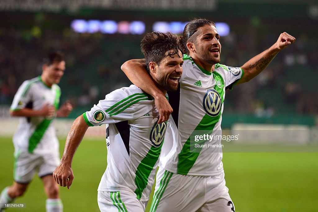 Diego of Wolfsburg celebrates scoring his goal with Ricardo Rodriguez during the second round DFB cup match between VfL Wolfsburg and Vfr Aalen at Volkswagen Arena on September 24, 2013 in Wolfsburg, Germany.