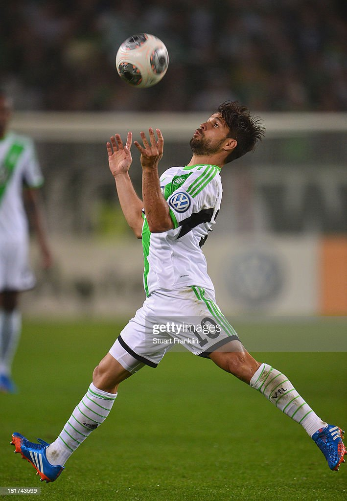Diego of Wolfsburg in action during the second round DFB cup match between VfL Wolfsburg and Vfr Aalen at Volkswagen Arena on September 24, 2013 in Wolfsburg, Germany.