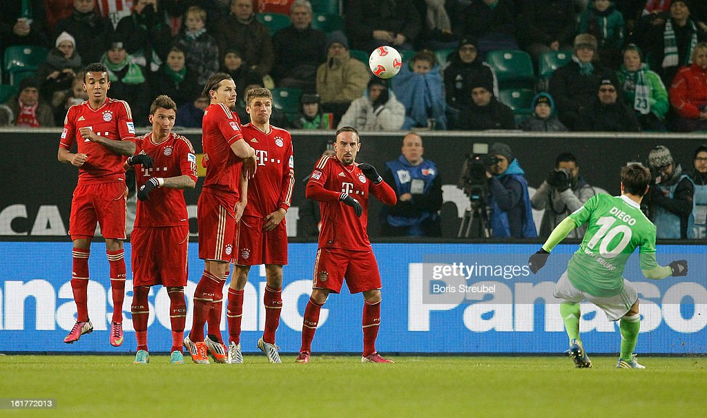 Diego (R) of Wolfsburg takes a free kick during the Bundesliga match between VFL Wolfsburg and FC Bayern Muenchen at Volkswagen Arena on February 15, 2013 in Wolfsburg, Germany.