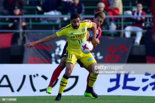 Diego Oliveira of Kashiwa Reysol and Akito Fukumori of Consadole Sapporo compete for the ball during the JLeague J1 match between Consadole Sapporo...