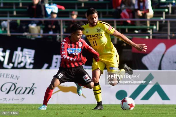 Diego Oliveira of Kashiwa Reysol and Chanathip Songkrasin of Consadole Sappporo compete for the ball during the JLeague J1 match between Consadole...