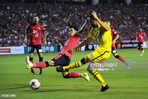 Diego Oliveira of Kashiwa Reysol and Hotaru Yamaguchi of Cerezo Osaka compete for the ball during the JLeague J1 match between Cerezo Osaka and...