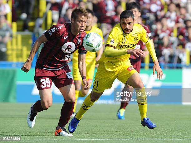 Diego Oliveira of Kashiwa Reysol and Masahiko Inoha of Vissel Kobe compete for the ball during the JLeague match between Kashiwa Reysol and Vissel...
