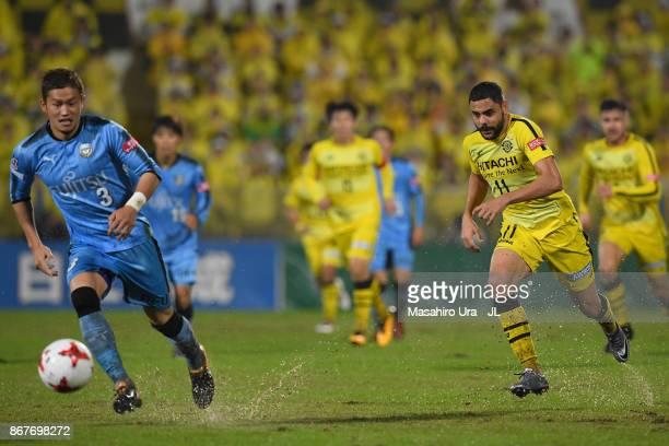 Diego Oliveira of Kashiwa Reysol and Tatsuki Nara of Kawasaki Frontale compete for the ball during the JLeague J1 match between Kashiwa Reysol and...