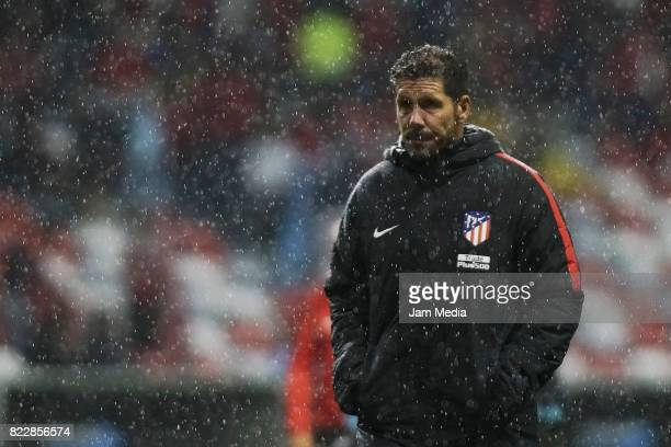 Diego Pablo Simeone Coach of Atletico de Madrid leaves the field during a friendly match between Toluca and Atletico de Madrid as part of the 100th...