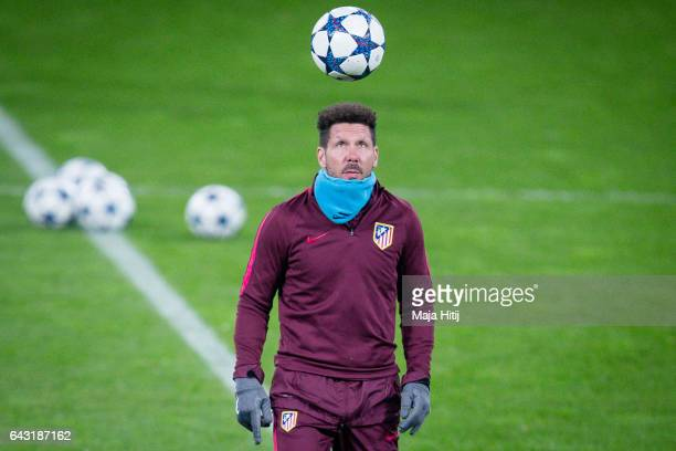 Diego Pablo Simeone head coach of Atletico controls the ball during the training prior the UEFA Champions League Round of 16 first leg match between...