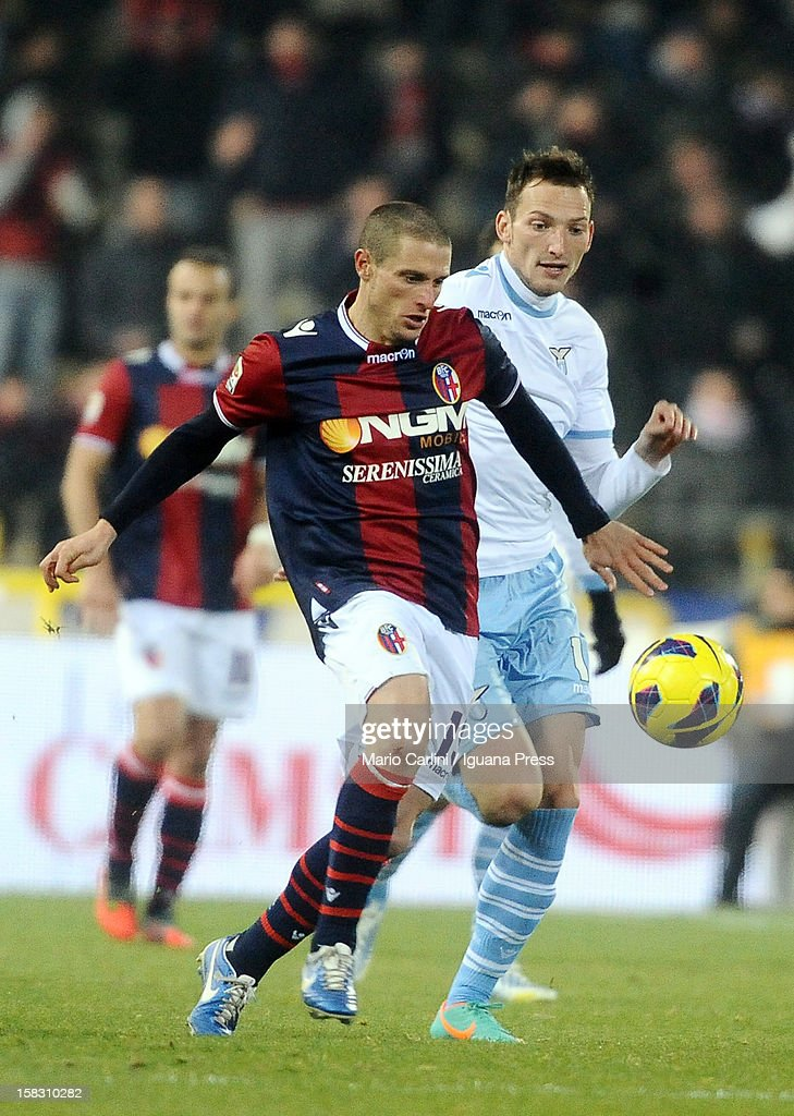 Diego Perez (L) of Bologna FC competes for the ball with Libor Kozak of SS Lazio during the Serie A match between Bologna FC and S.S. Lazio at Stadio Renato Dall'Ara on December 10, 2012 in Bologna, Italy.